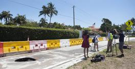 A TV crew reports next to a recently opened sinkhole near President Donald Trump's Mar-a-Lago estate (Daily News/AP)