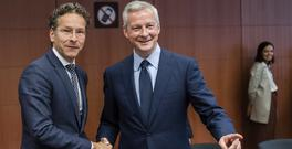 Jeroen Dijsselbloem, left, with France's Bruno Le Maire at a meeting of eurozone finance ministers in Brussels (AP)