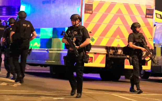 Armed police man roadblocks outside the arena after reports of an explosion at the venue during an Ariana Grande gig. Photo: PA