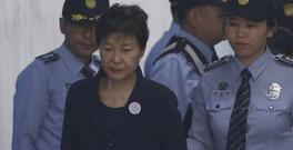 Park Geun-hye arrives at a court in Seoul for the beginning of her corruption trial. (AP)