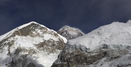 FILE - In this March 7, 2016 file photo, Mt. Everest, in middle, altitude 8,848 meters (29,028 feet), is seen on the way to base camp. Nepali climbers said Tuesday that a rocky outcrop near the top of Mount Everest known as the
