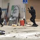This image provided by an activist shows Bahraini security forces during the raid on Diraz (AP Photo)