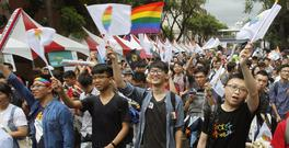 Same-sex marriage supporters cheer after the decision. (AP/Chiang Ying-ying)