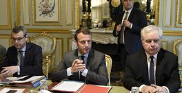French President Emmanuel Macron, centre, flanked by Secretary General of the Elysee presidential Palace Alexis Kohler, left, and Admiral Bernard Rogel, chairs a Defence Council at the Elysee Palace on Wednesday (AP)