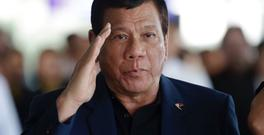 Philippine President Rodrigo Duterte salutes as he arrives at Manila's international airport. (AP/Aaron Favila)
