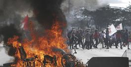 Demonstrators create a flaming barricade during an anti-government protest in Brasilia (Eraldo Peres/AP)