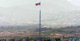 A giant North Korean flag flutters on the top of a 533ft tower (AP)