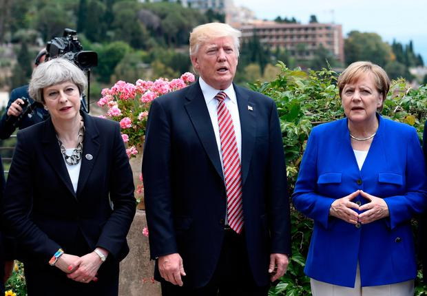 Britain's Prime Minister Theresa May, US President Donald Trump and German Chancellor Angela Merkel. Photo: AFP/Getty