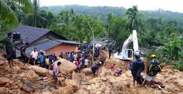 Sri Lankans watch military rescue efforts at the site of a landslide at Bellana village in Kalutara district (AP)