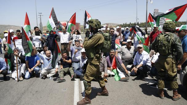 Palestinians protest in solidarity with prisoners on hunger strike in Israeli jails (AP)