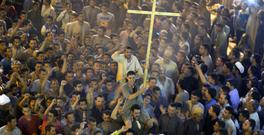 Coptic Christians shout slogans after the funeral service of some of the victims of a bus attack in Minya, Egypt (AP Photo/Amr Nabil)