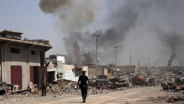 Smoke rises during heavy fighting between IS militants and Iraqi special forces in the industrial area of west Mosul (AP Photo/Maya Alleruzzo, File)