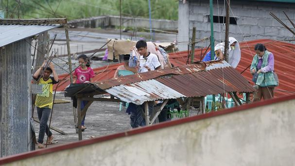 Some residents refused to abandon their homes as government forces continue to battle Muslim militants in Marawi, southern Philippines (AP Photo/Bullit Marquez)