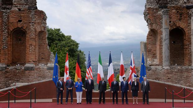 G7 leaders agree to fight protectionism, but USA hedges on Paris Agreement