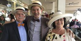 Uber's chief executive Travis Kalanick with his mother Bonnie and Donald at the Kentucky Derby earlier this month (Travis Kalanick/Uber via AP)