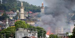 A fire rages following air strikes by the Philippine air force in Marawi (AP Photo/Bullit Marquez)
