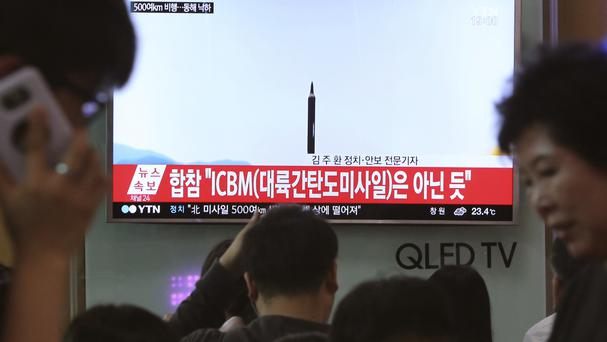 People at Seoul railway station last week watching a TV news programme showing a file image of a missile launch conducted by North Korea (AP Photo/Ahn Young-joon, File)