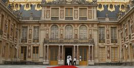 The red carpet is set up prior to the welcoming ceremony between French president Emmanuel Macron and his Russian counterpart Vladimir Putin at the Palace of Versailles, near Paris (AP)