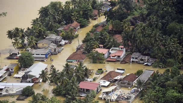 Sri Lankan government battles to rescue thousands before rains resume
