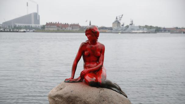 Red paint covers the vandalized tourist attraction The Little Mermaid in Copenhagen (AP)