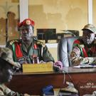 The judges sit in the courtroom during the trial of South Sudanese soldiers accused of an attack during the country's civil war (AP)