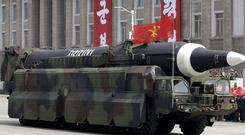 An unidentified missile that analysts believe could be the North Korean Hwasong 12 is paraded in Kim Il Sung Square in Pyongyang (AP)