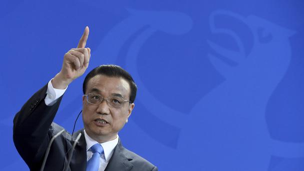 Chinese premier Li Keqiang speaks during a joint press conference with German chancellor Angela Merkel in Berlin (AP)