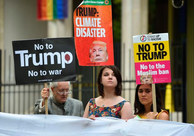 Protesters outside the US embassy in London yesterday. Photo: PA