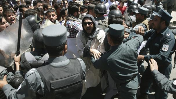 Police clash with protesters during the demonstration in Kabul (AP)