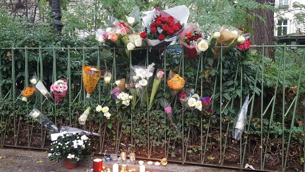 Candles and flowers opposite the Bataclan concert hall in Paris, France