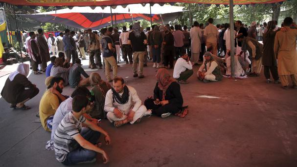 Protesters sit under a tent near Wednesday's suicide attack site in Kabul (Massoud Hossaini/AP/PA)