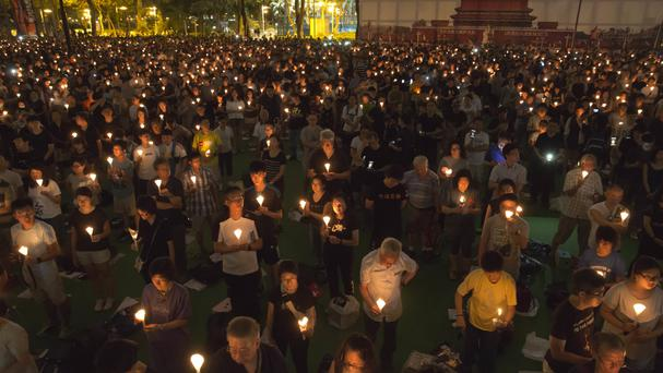 Tens of thousands of people attend an annual candlelight vigil at Hong Kong's Victoria Park (AP)