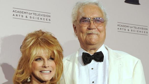 Roger Smith pictured with his wife Ann-Margret in 2010 (AP)