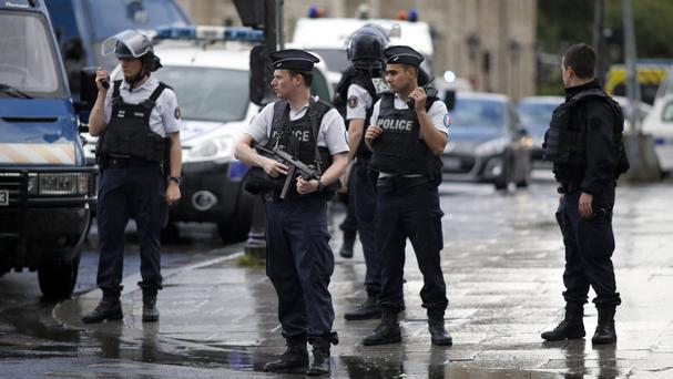 Police at the scene of the incident at the Notre-Dame Cathedral in Paris, France (Matthieu Alexandre/AP)