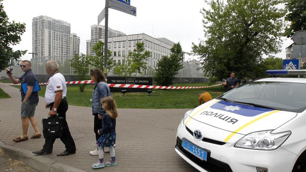 The US embassy is secured by police after an explosion on its territory in Kiev, Ukraine (Sergei Chuzavkov/AP)