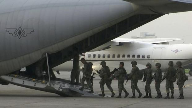 Marines board a transport plane in Manila for deployment in the southern Philippines city of Marawi where ongoing violence has killed scores of people (AP Photo)