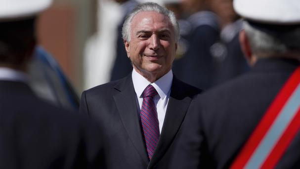 Brazil's President Michel Temer will remain in office (AP)