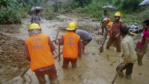 Rescuers search the mud after a landslide in Bandarban, Bangladesh (AP Photo)