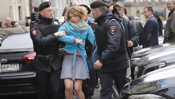 Russian police detain a protester against Moscow City's project to pull down Soviet-era apartment blocks (Alexander Zemlianichenko/AP)