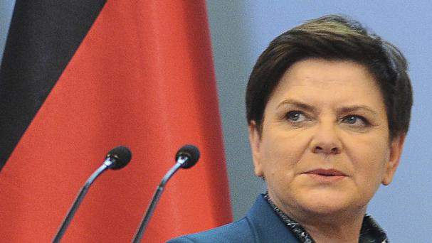 Beata Szydlo grew up in the town of Oswiecim, where the former death camp is located (AP)