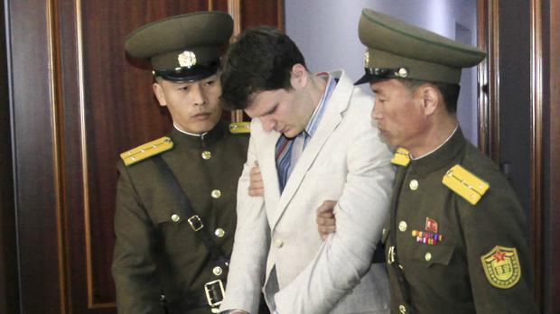 A handcuffed Otto Warmbier under guard at the Supreme Court in Pyongyang in March 2016 (AP)