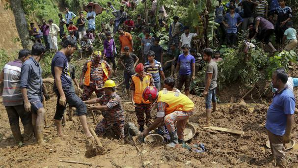Rescue work after Tuesday's massive landslide in Rangamati district, Bangladesh (AP Photo)