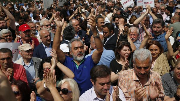 Supporters of Turkey's pro-secular Republican People's Party, CHP, chant slogans as they gather for a protest in Istanbul (AP)