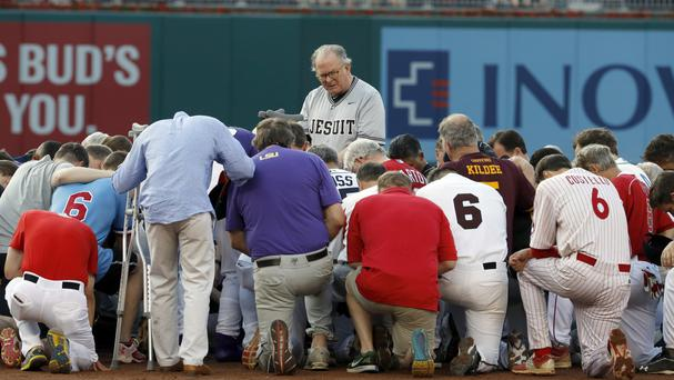 House of Representatives chaplain the Rev Patrick Conroy leads a prayer as both teams kneel before the congressional baseball game (AP)