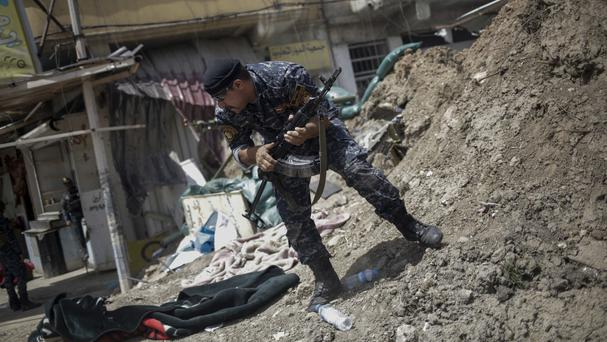 Battles are raging in Mosul's Old City, as Iraqi forces bid to push out Islamic State (Bram Janssen/AP)