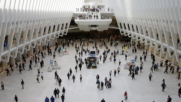 On the move: A tide of humanity - and potential data - at the Oculus, the new transport hub at the World Trade Centre in New York (AP)