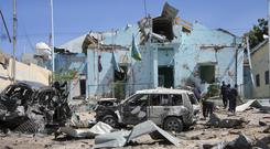 Somali security forces attend the scene of a car bomb attack in Mogadishu (Farah Abdi Warsameh/AP)