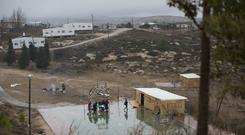 Jewish settlers in Amona, an unauthorised Israeli outpost in the West Bank (Oded Balilty/AP)