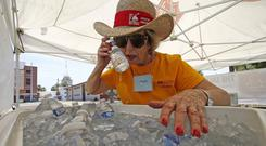 Salvation Army volunteer Jackie Rifkin tries to keep cool in Phoenix (Ross D Franklin/AP)