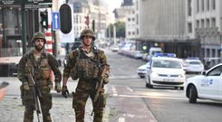 Belgian soldiers patrol outside Central Station in Brussels (AP)